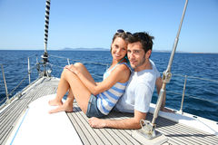 Happy couple on a sailing boat Royalty Free Stock Photos