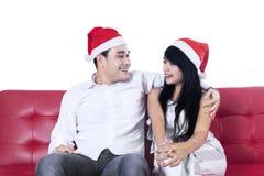 Happy couple in santa hats Royalty Free Stock Photo