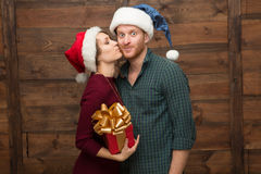 Happy couple in Santa hats Stock Images