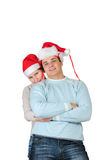 Happy couple in santa's hats Stock Images