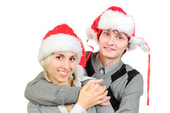 Happy couple in santa's hats Royalty Free Stock Photo