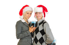 Happy couple in santa's hats Stock Photos