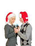Happy couple in santa's hats Stock Photography