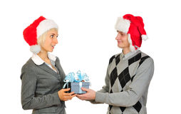Happy couple in santa's hats Royalty Free Stock Photography