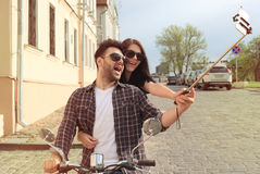 Happy couple on scooter Stock Photography
