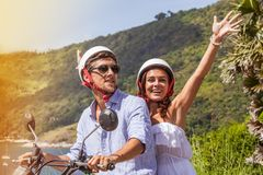 Happy couple on a scooter stock photography