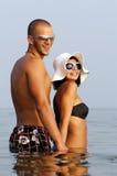 Happy couple in sea Stock Photos