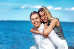 Happy couple on sea background. happy young romantic couple in love have fun on l beach at beautiful summer day. Happy couple on sea background. happy young Stock Photos