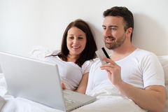 Happy couple searching for consumer advice in internet Royalty Free Stock Photography
