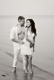 Happy couple in the seaside Stock Photography