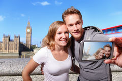 Happy couple selfie in london Stock Photos
