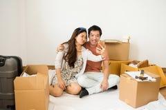 happy couple selfie in new home Stock Photos