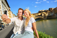 Happy couple selfie photo on travel in Florence stock images
