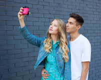 Happy couple selfie selfportrait. Beautiful young multiracial travel couple having fun. Hispanic man, Caucasian girl Royalty Free Stock Photos
