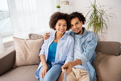 Happy couple with selfie stick at home Stock Photos
