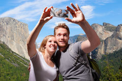 Happy couple selfie in yosemite royalty free stock photos