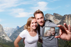 Happy couple selfie in yosemite Royalty Free Stock Image