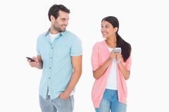 Happy couple sending text messages Stock Photos