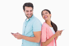 Happy couple sending text messages Stock Image