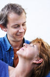 Happy couple series. Concept happy couple with woman looking up to her man, embraced from him and laying on his shoulder royalty free stock photography