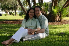 Happy couple series 6. On the lawn Royalty Free Stock Photo