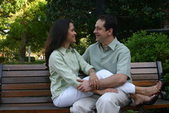 Happy couple series 7. On the bench Stock Photography