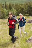 Happy couple setting out on a hike Royalty Free Stock Photography