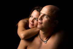 Happy couple. Sexy couple isolated in a black background Royalty Free Stock Image