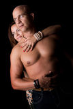Happy couple. Sexy couple isolated in a black background Stock Photography