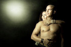 Happy couple. Sexy couple isolated in a black background Royalty Free Stock Photos