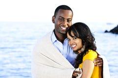 Happy couple sharing blanket Royalty Free Stock Photos