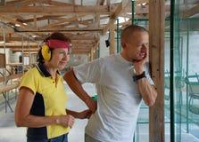 Happy couple at shooting range. Preparing to shoot Stock Photo