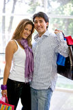 Happy couple shopping Stock Photos