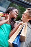 Happy couple shopping Stock Images