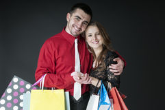 Happy  couple   with shopping bags Royalty Free Stock Photography