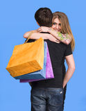 Happy couple with shopping bags Royalty Free Stock Image