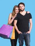 Happy couple with shopping bags Royalty Free Stock Photos
