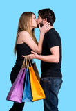 Happy couple with shopping bags Royalty Free Stock Images