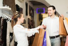 Happy couple with shopping bags. At boutique Royalty Free Stock Photography