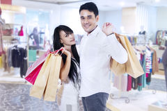 Happy couple with shopping bags. In the shopping center royalty free stock photography