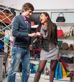 Happy couple with shopping bags and credit card Royalty Free Stock Photo