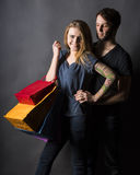 Happy couple with shopping bags Stock Images