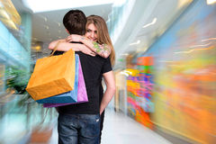 Happy couple with shopping bags Stock Image