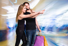Happy couple with shopping bags. In the mall Stock Photo