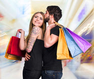Happy couple with shopping bags. In the mall Stock Image