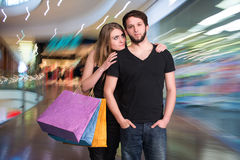 Happy couple with shopping bags. In the mall Royalty Free Stock Photography