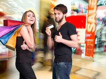 Happy couple with shopping bags in the mall Stock Image