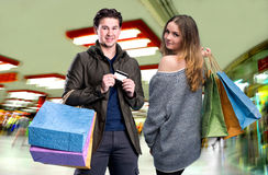 Happy couple with shopping bags in the mall Royalty Free Stock Photo