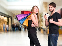 Happy couple with shopping bags at the mall Royalty Free Stock Images