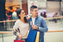 Happy couple with shopping bags. Portrait of happy couple with shopping bags Stock Photos